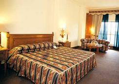 Hotel Crown Plaza Islamabad - 이슬라마바드 - 침실