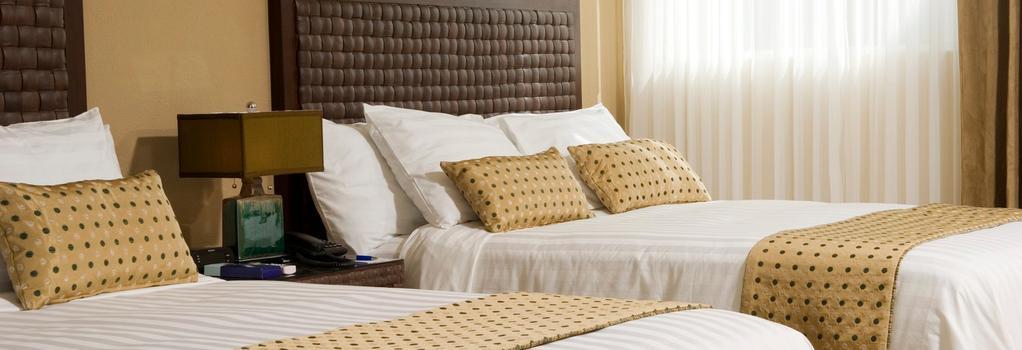 Rincón del Valle Hotel & Suites - 산호세 - 침실