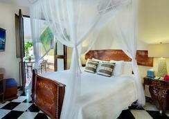 Villa Herencia Hotel - 산후안 - 침실