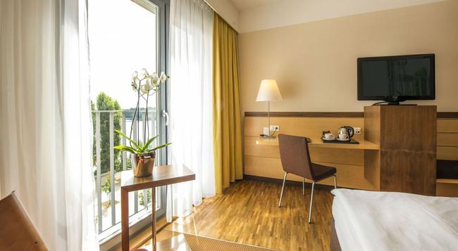센트로비탈 호텔 - 베를린 - 침실