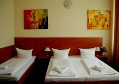 시티 호텔 암 쿠푸에스텐담 - 베를린 - 침실