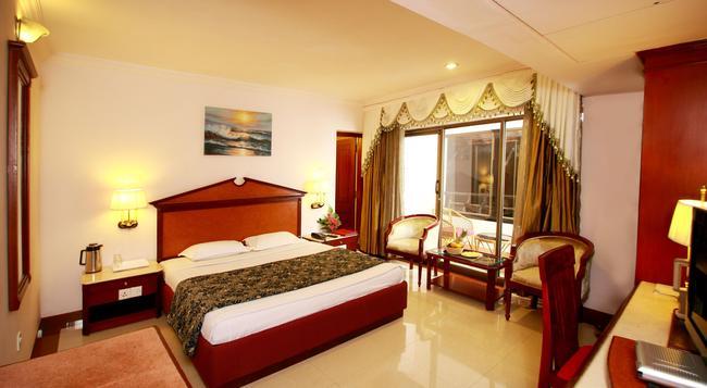 웨스트웨이 호텔 칼리컷 - Kozhikode - 침실