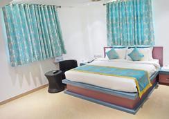 프론트라인 레지던시 - Patna - 침실