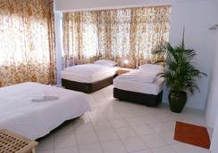 오렌지 페코에 게스트하우스 - 쿠알라룸푸르 - 침실