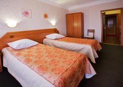 투어리스트 호텔 - Omsk - 침실