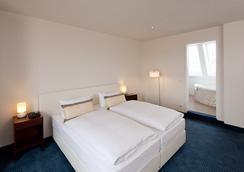 시티 호텔 베를린 미테 - 베를린 - 침실