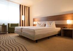 시티 호텔 베를린 이스트 - 베를린 - 침실