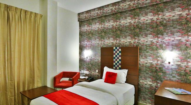 Hotel Vels Grand Inn - Coimbatore - 침실