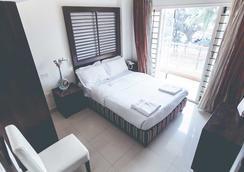 로얄 스위트 호텔 아파트먼트 - 벵갈루루 - 침실