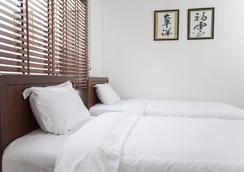 Pacific Vientiane Hotel - 비엔티안 - 침실