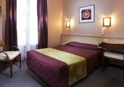 호텔 플로르 리볼리 - 파리 - 침실