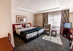 코트야드 호텔 샌드톤 요하네스버그 - 요하네스버그 - 침실