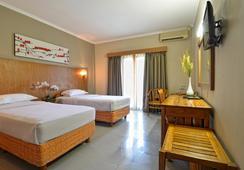 타만 로사니 호텔 앤 빌라 - 쿠타 - 침실