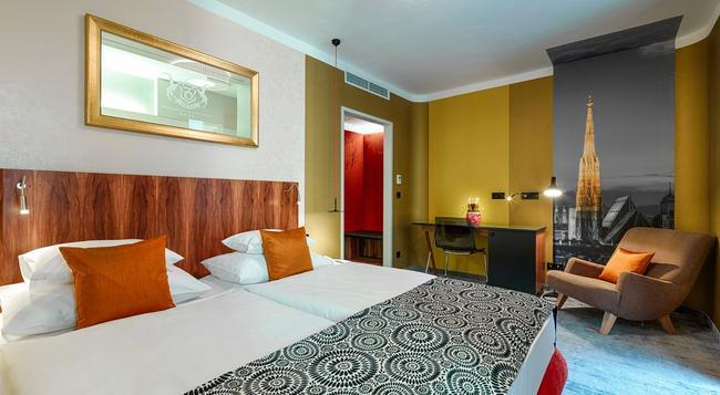 호텔 카프리코노 - 빈 - 침실