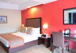 더 클라우드 호텔 - 아마다바드 - 침실