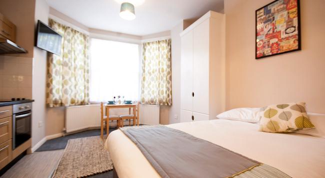 유나이티드 로지 호텔 - 런던 - 침실
