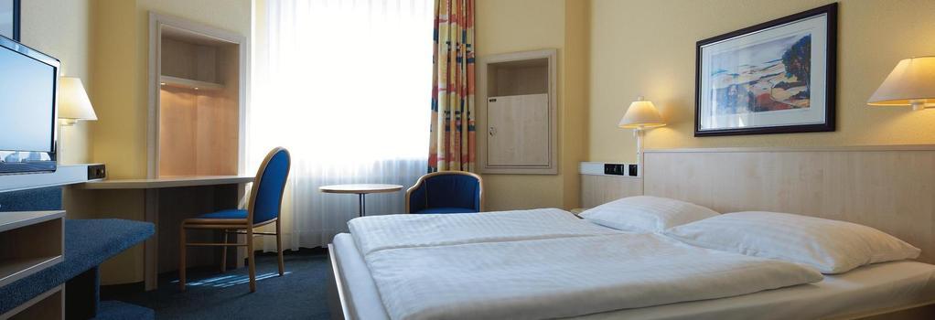 Intercityhotel Erfurt - 에르푸르트 - 침실