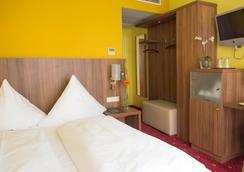 호텔 슐리커 - 뮌헨 - 침실