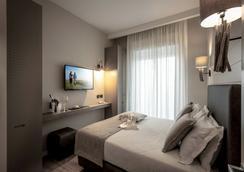Litoraneo Suite Hotel - 리미니 - 침실
