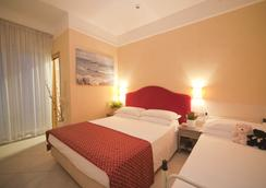Hotel Adlon - 리치오네 - 침실
