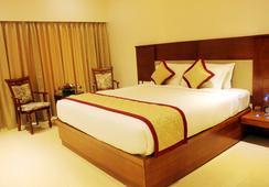 리오 더 호텔 - 벵갈루루 - 침실