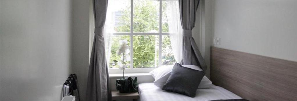 호텔 라이브러리 암스테르담 - 암스테르담 - 침실