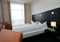 플레밍스 컨퍼런스 호텔 프랑크프루트 - 프랑크푸르트 - 침실