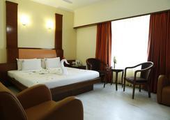 Ulo Hotels Chennai Deluxe - 첸나이 - 침실