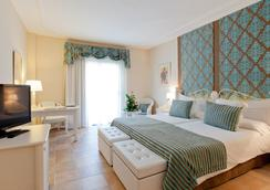Lago Garden Apart-Suites & Spa Hotel - Cala Ratjada - 침실
