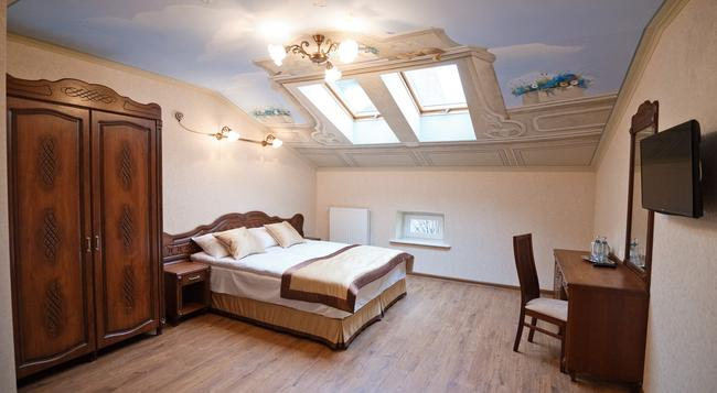 Guest House Inn Lviv - 리보프 - 침실