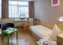 올유니드 호텔 잘츠부르크 - 잘츠부르크 - 침실