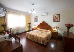 Hotel Nirvana - 리마 - 침실